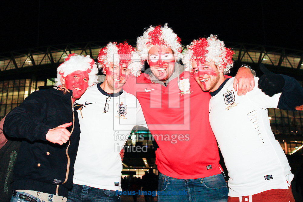 Picture by Andrew Tobin/Focus Images Ltd +44 7710 761829<br /> 19/11/2013 England fanswearing coloured wigs with face paint  arrive at Wembley Stadium before the International Friendly match at Wembley Stadium, London.