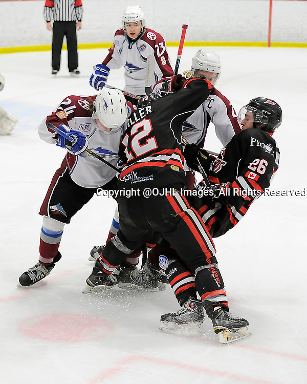 FORT FRANCES, ON - Apr 28, 2015 : Central Canadian Junior &quot;A&quot; Championship, game action between the Soo Thunderbirds and the Dryden GM Ice Dogs, game one of the Dudley Hewitt Cup, Troy Williams #23 and Blake Berg #24 of the Dryden GM Ice Dogs battle for the puck with Joey Miller #12 and Eric Hillock #26 of the Soo Thunderbirds<br /> (Photo by Amy Deroche/ OJHL Images)