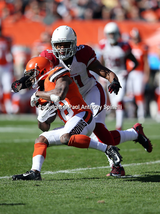 Arizona Cardinals middle linebacker Kevin Minter (51) gives chase as Cleveland Browns wide receiver Taylor Gabriel (18) runs with the ball as he catches a first quarter pass for a 6 yard gain during the 2015 week 8 regular season NFL football game against the Arizona Cardinals on Sunday, Nov. 1, 2015 in Cleveland. The Cardinals won the game 34-20. (©Paul Anthony Spinelli)