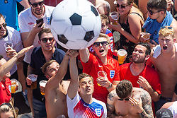 Fans punch away a blow up prior to kick off - Ryan Hiscott/JMP - 07/07/2018 - FOOTBALL - Ashton Gate - Bristol, England - Sweden v England, World Cup Quarter Final, World Cup Village at Ashton Gate