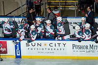 KELOWNA, CANADA - DECEMBER 30: Kelowna Rockets' coaching staff Kris Mallette, Jason Smith and Travis Crickard stand on the bench as the players celebrate a shoot out win against the Victoria Royals on December 30, 2017 at Prospera Place in Kelowna, British Columbia, Canada.  (Photo by Marissa Baecker/Shoot the Breeze)  *** Local Caption ***