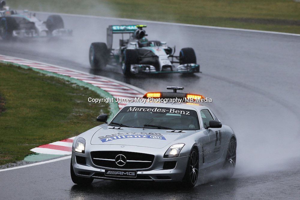 Nico Rosberg (GER) Mercedes AMG F1 W05 leads behind the FIA Safety Car.<br /> Japanese Grand Prix, Sunday 5th October 2014. Suzuka, Japan.