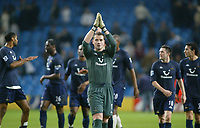 11/12/2004 - FA Barclays Premiership - Manchester City v Tottenham Hotspur - The City of Manchester Stadium.<br />Tottenham Hotspur goalkeeper Paul Robinson walks ahead of his fellow team mates and applaudes the away supporters after their 1-0 win.<br />Photo:Jed Leicester/Back Page Images