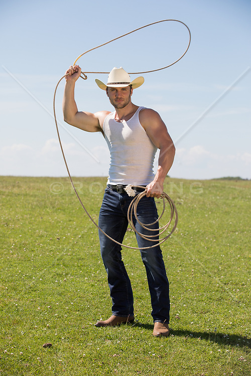 cowboy with a lasso on a ranch