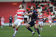Doncaster Rovers forward Andy Williams (11)  and Blackpool defender Clark Robertson (5)  wait for the ball  during the Sky Bet League 1 match between Doncaster Rovers and Blackpool at the Keepmoat Stadium, Doncaster, England on 28 March 2016. Photo by Simon Davies.