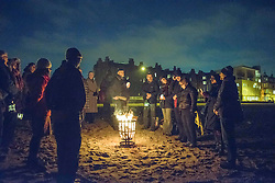 The community of Portobello gathered on the beach tonight to pray for a light for Aleppo. Jon Davey/ EEm