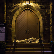 WASHINGTON, DC - OCT11: A homeless man sleeps outside of Luther Place Memorial Church, October 10, 2014. (Photo by Evelyn Hockstein/For The Washington Post)