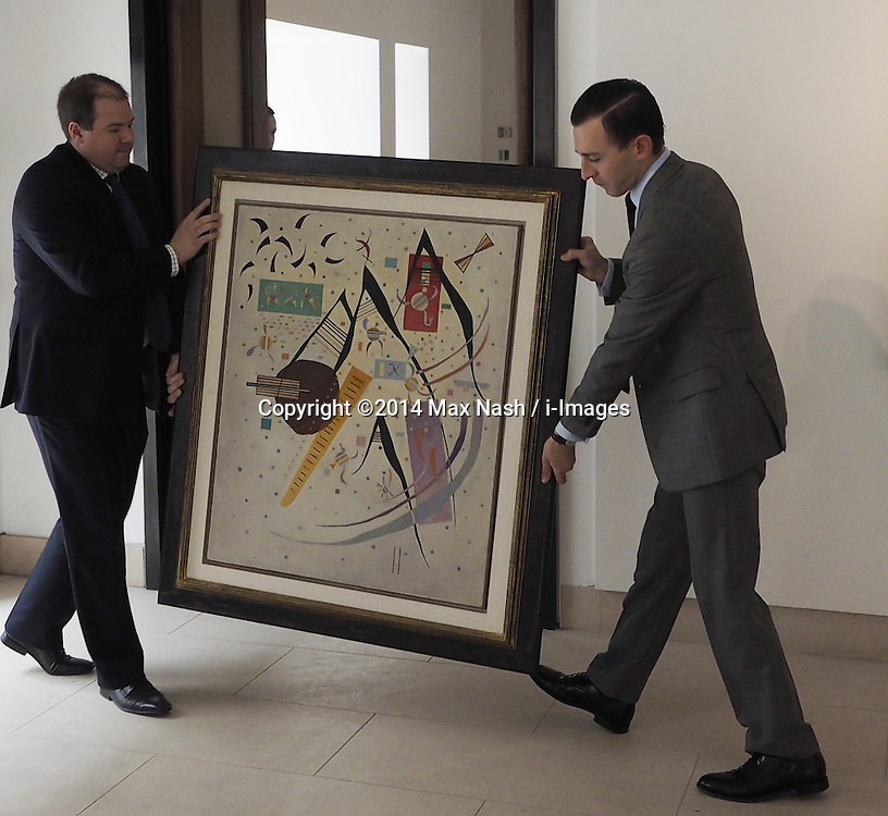 Two Christie specialist move Kadinsky's, 1937 Schwarze Spitzen, (estimated at $4-5 million) at Christies Impressionist and Modern Art. display of highlights for the upcoming New York auction on May 6, 2014. Photo taken in London, United Kingdom. Friday, 28th March 2014. Picture by Max Nash / i-Images