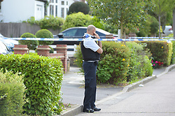 © Licensed to London News Pictures. 15/07/2019. London UK: Police officers close off Malvern Drive in Woodford Green, Essex after a male in his forties was found with gun shot wounds and rushed to hospital, where his condition is described as critical  , Photo credit: Steve Poston/LNP