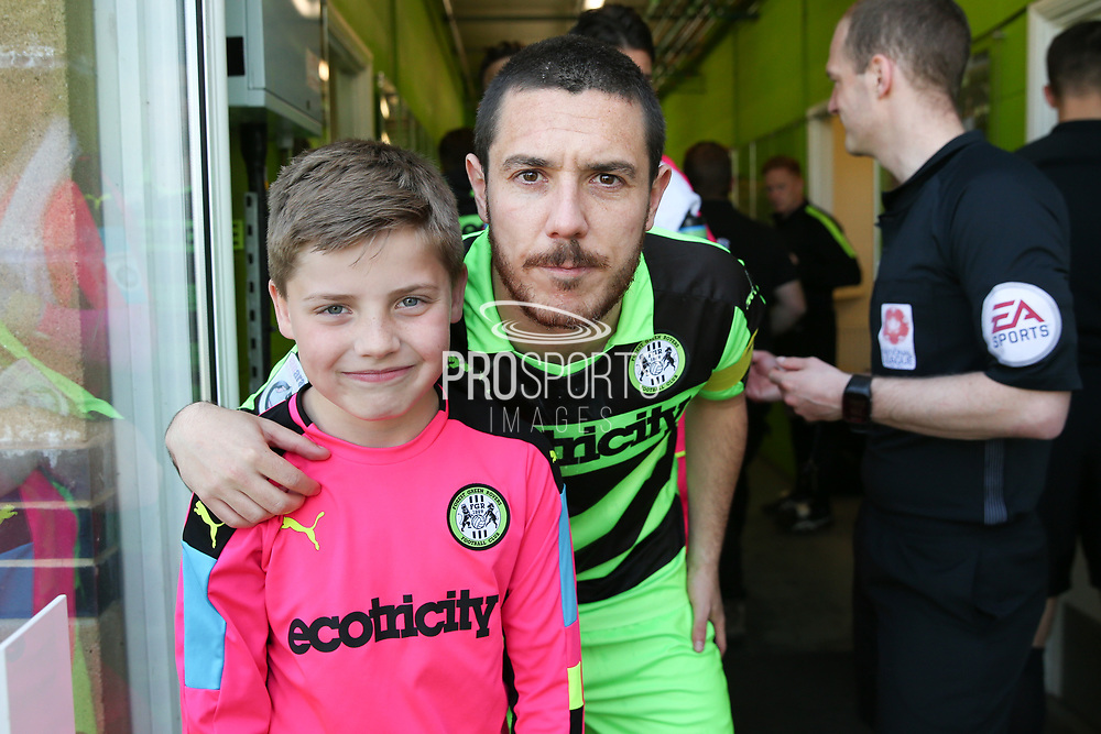 Forest Green Rovers Liam Noble(15) with the FGR mascot during the Vanarama National League Play Off second leg match between Forest Green Rovers and Dagenham and Redbridge at the New Lawn, Forest Green, United Kingdom on 7 May 2017. Photo by Shane Healey.