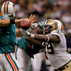 2009 September 03: New Orleans Saints defensive end Anthony Hargrove (69) pressures Miami Dolphins quarterback Chad Henne (7) during a preseason game between the Miami Dolphins and the New Orleans Saints at the Louisiana Superdome in New Orleans, Louisiana.