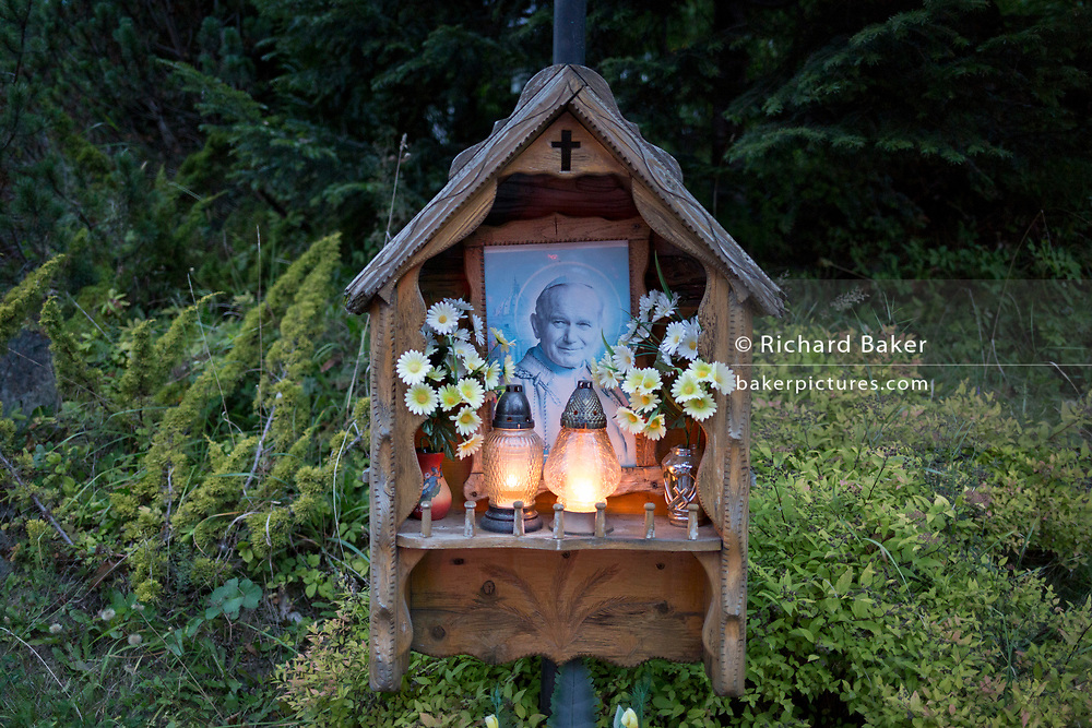 Candles burn in a shrine to Polish-born Pope John Paul II, on 16th September 2019, in Koscielisko, Zakopane, Malopolska, Poland. Jan Pawel II; born Karol Jozef Wojtyla (1920-2005) was head of the Catholic Church and sovereign of the Vatican City State from 1978 to 2005.