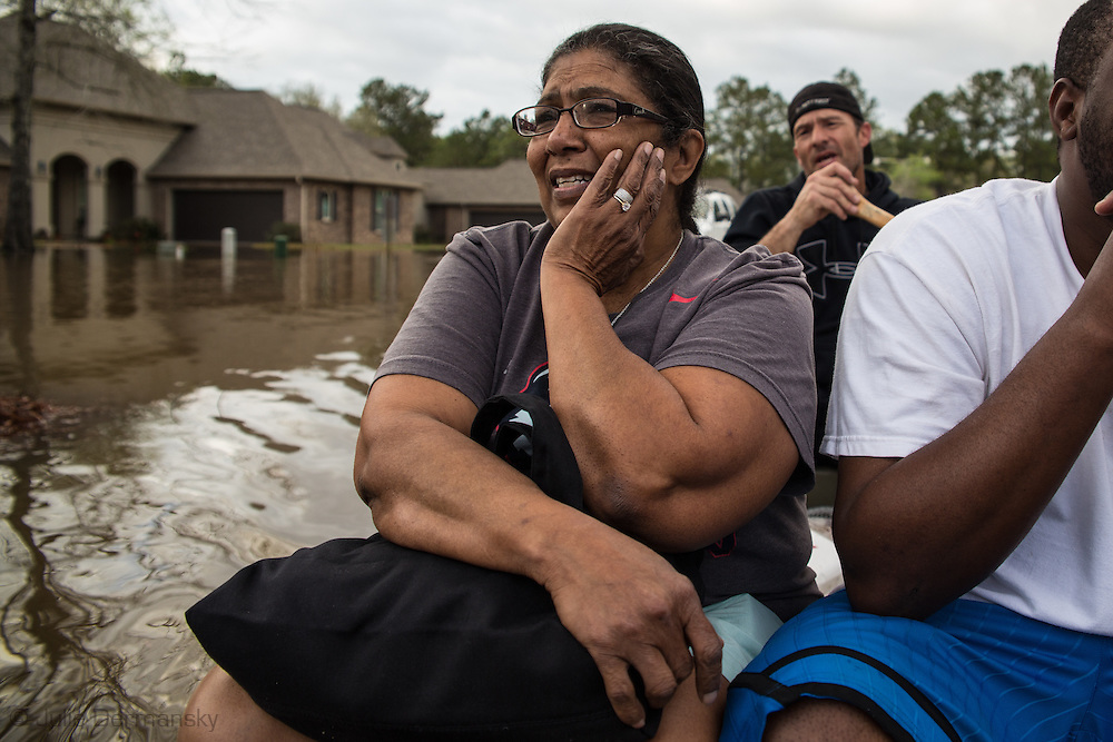 Covington Louisiana, March, 12, 2016,  Vera Esteen leaving her home in Tallow Creek by boat, as waters continued to rise. 14 inches of rain fell in less than 24 hours, after three days of intermittent rain, causing flash floods. The Tchefuncte River  and Bogue Falaya River<br />  crested on Saturday morning but the flood event continued into the night for those in Tallow Creek.