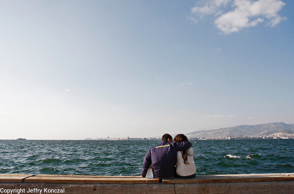A couple embrace along the coast of Izmir, Turkey