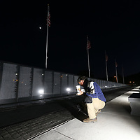 General Contractor Clay Stewart puts one more coat of sealer on the bricks that line the walkway of the replecia Vietnam Memorial Wall that opens this Thursday at Veterans Park in Tupelo.