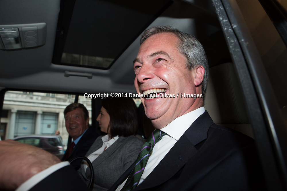 Ngel Farage deliver speech after significant gains. The leader of UKIP party Nigel Farage smile to photographers after giving a party speech in central London after his significants gains in the European and Council elections. InterContinental Hotel, London, United Kingdom. Monday, 26th May 2014. Picture by Daniel Leal-Olivas / i-Images