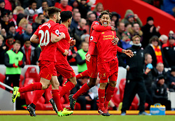 Roberto Firmino of Liverpool celebrates after scoring the equalising goal to make it 2-2 ahead of manager Jurgen Klopp - Mandatory by-line: Matt McNulty/JMP - 21/01/2017 - FOOTBALL - Anfield - Liverpool, England - Liverpool v Swansea City - Premier League
