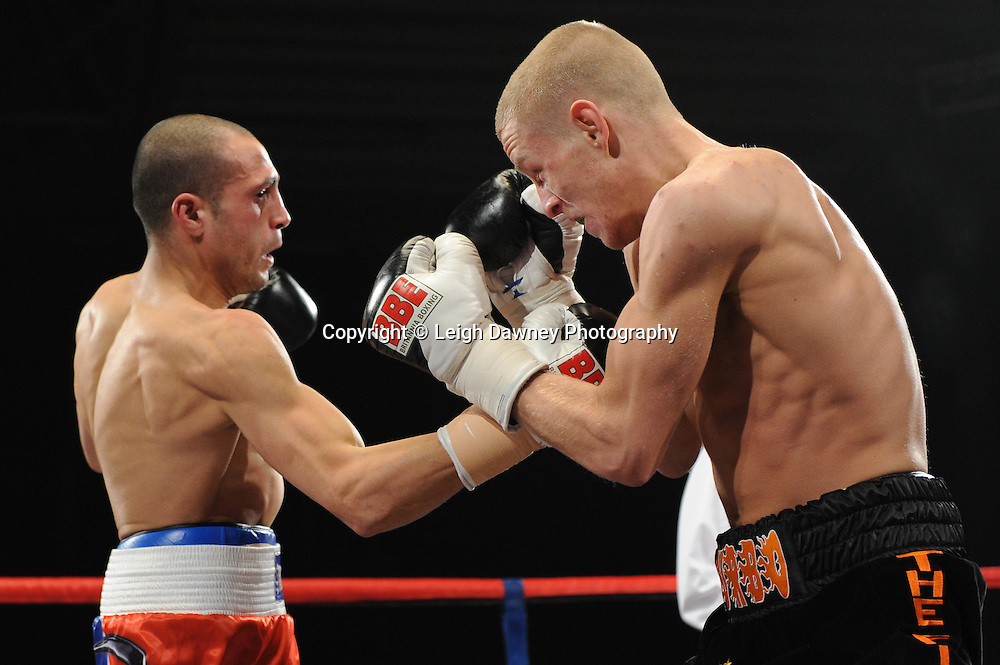 Terry Flannigan claims victory after Stoyan Serbezov is in no way able to continue due to a arm injury - 22nd January 2011 at Doncaster Dome, Doncaster - Frank Maloney Promotions. Credit © Leigh Dawney.
