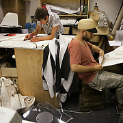 Christopher Kelly, one of the designers of the giant bear, works on making the covers for the steel structure. Aurora is a giant polar bear puppet, the size of a London double decker bus. The bear is the brain child of Greenpeace UK and it will be the center piece in the Greenpeace campaign Save the Arctic  global day of action in London Sept 15th. Aurora is designed by Christopher Kelly in collaboration with props designer Simon Costin and made by Factory Settings in East London.