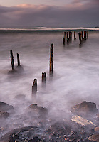 By using Dark Filters and a long exposure the water crashing into St. Claire Beach was given a dreamy appearance as it swirled back and forth...   Since this image was captured major storms have destroyed most of what was captured here.