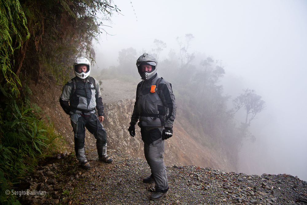 Eric Hougen and Bill Dragoo stand on the edge of the Death Road to Coroico that slid into a canyon near Unduavi, in the yungas region of the Bolivian Andes.