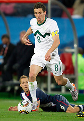 Steve Cherundolo of USA and Robert Koren of Slovenia during the 2010 FIFA World Cup South Africa Group C match between Slovenia and USA at Ellis Park Stadium on June 18, 2010 in Johannesberg, South Africa. (Photo by Vid Ponikvar / Sportida)