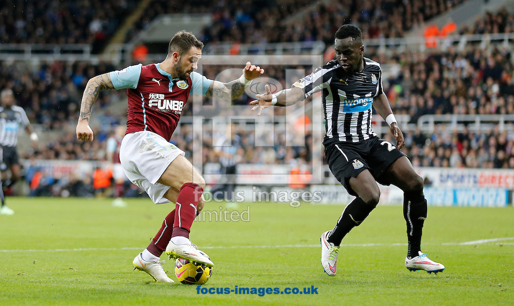Cheik Ismael Tiote (r) of Newcastle United and Danny Ings of Burnley during the Barclays Premier League match at St. James's Park, Newcastle<br /> Picture by Simon Moore/Focus Images Ltd 07807 671782<br /> 01/01/2015