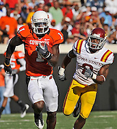 Nov 01, 2008; Stillwater, OK, USA; Oklahoma State Cowboys wide receiver Dez Bryant (1) rushes past Iowa State Cyclones defensive back Chris Brown (8) after catching a pass for a 80-yard touchdown during the second quarter at Boone Pickens Stadium.