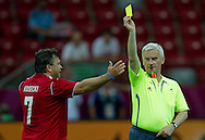 "(R) Former President of Polish Football Association Michal Listkiewicz shows yellow card for (L) famous former Polish soccer player Roman Kosecki  during demonstration match of the Special Olympics as part of the Respect Inclusion ""Football With No Limits"" before the UEFA EURO 2012 Quarterfinal football match between Portugal and Czech Republic at National Stadium in Warsaw on June 21, 2012...Poland, Warsaw, June 21, 2012..Picture also available in RAW (NEF) or TIFF format on special request...For editorial use only. Any commercial or promotional use requires permission...Photo by © Adam Nurkiewicz / Mediasport"