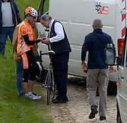 Quievy - Sunday, Apr 13 2008: . An EUSKALTEL - EUSKADI rider has his wrist examined by the race doctor prior to abandoning the race. Images from the 106th edition of the Paris Roubaix (1.HC) cycle race. Starting in Compiègne, north of Paris, the race finishes 259.5 km later in Roubaix. This year's edition included 52.8 km on the famous pavé. (Photo by Peter Horrell / http://www.peterhorrell.com)