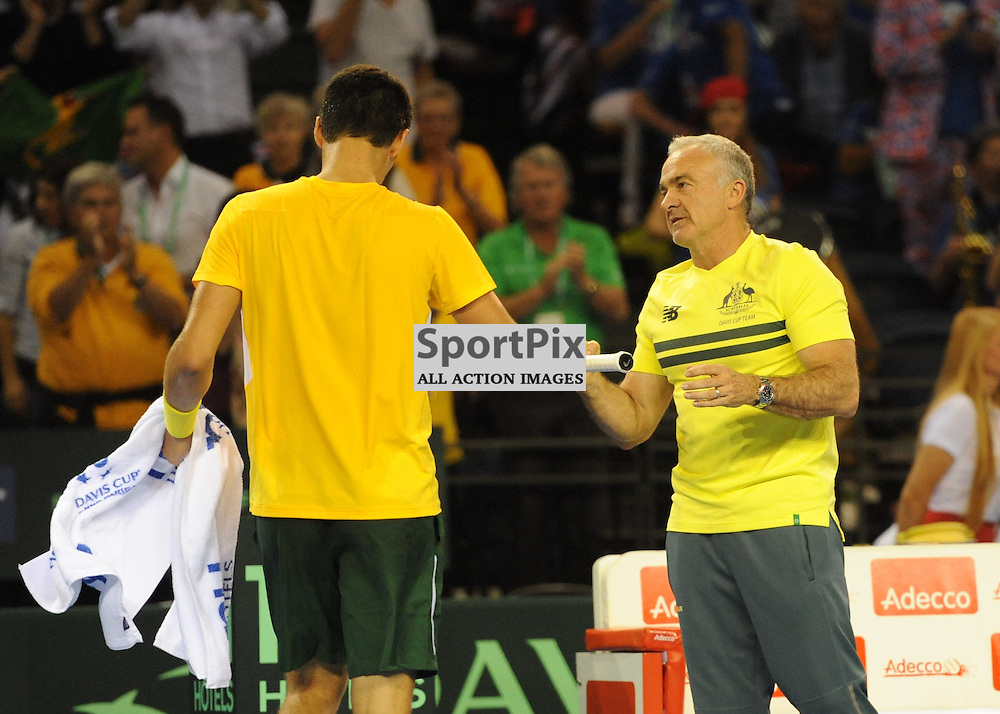 Bernard Tomic is congratulated by his team coach Wally Masur after winning the second set during the Great Britain v Australia, Semi Finals,  Aegeon Davis Cup by BNP Paribas, Friday 18 September 2015 (c) Angie Isac | SportPix.org.uk