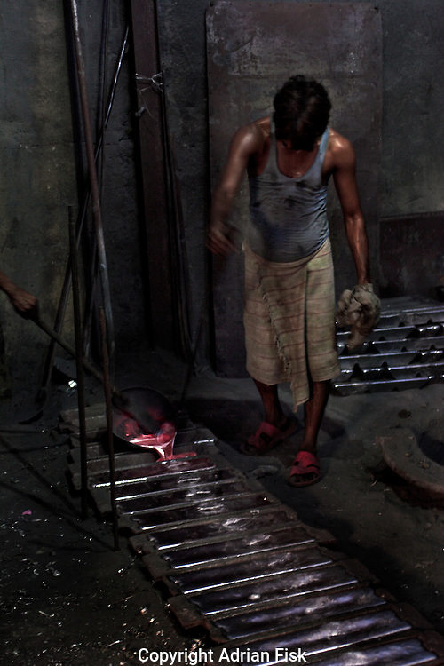 The aluminium smelter melts cans to make bars of pure aluminium. It takes 40 330 ml cans to make one bar.