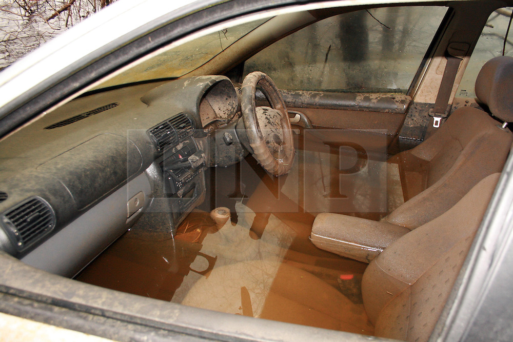 © London News Pictures. 20/03/14 A submerged car, which became the unofficial symbol of the Somerset floods, has apparently been sold for £101,100 on eBay. Hubert Zajaczkowski, 21, sold the Seat Toledo to raise money for a charity. FILE PICTURED DATED 11/03/2014 . Muchelney, UK. A car stander on the Langport to Mulchelney road on the Somerset Levels, which has now been there since christmas. The car is showing significant sigs of water damage.. Photo credit : Jason Bryant/LNP