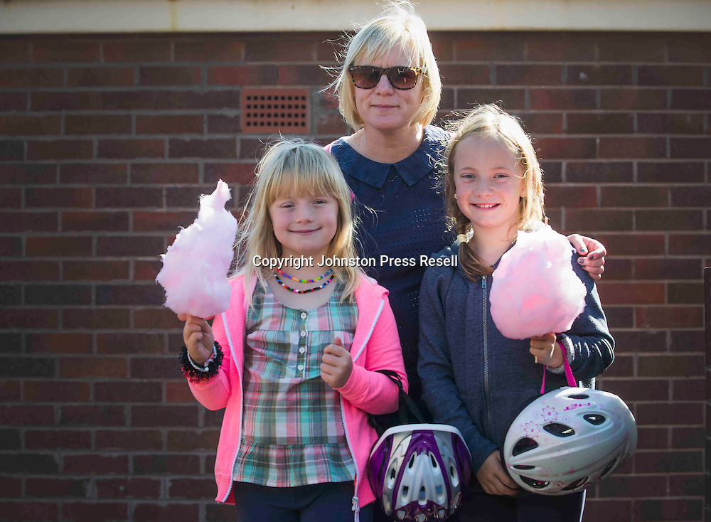 Nicky Gibson with daughters Polly Campbell (10) and Patsy Campbell (7) enjoy their candy floss.<br /> <br /> Edinburgh Cat and Dog Home open day. <br /> 6th September 2015<br /> <br /> picture by Alex Hewitt<br /> alex.hewitt@gmail.com<br /> 07789 871 540