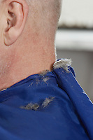 Hair on mans shoulders after haircut at barbers close-up