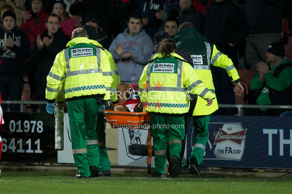 WREXHAM, WALES - Wednesday, january 18, 2012: Wrexham's Danny Wright is carried off after suffering a dislocated elbow during the FA Cup 3rd Round Replay match against Brighton & Hove Albion at the Racecourse Ground. (Pic by David Rawcliffe/Propaganda)
