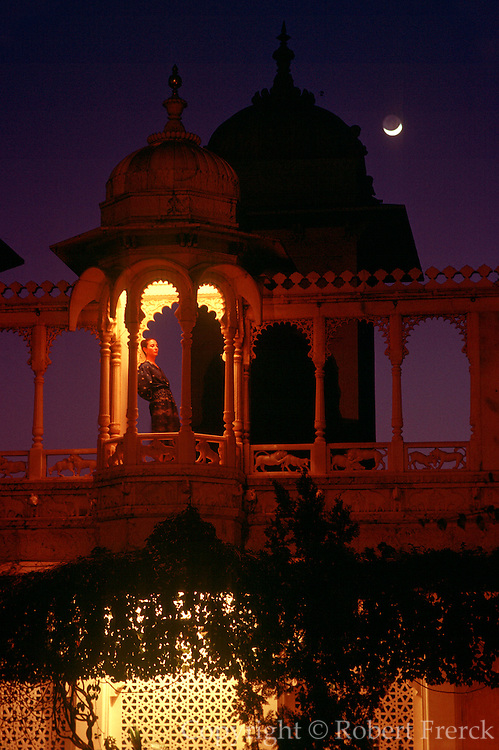 INDIA, RAJASTHAN Udaipur; a young woman in a tower of the famous Lake Palace Hotel on Lake Pichola
