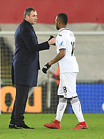 Football - 2017 / 2018 Premier League - Swansea City vs. West Bromwich Albion<br /> <br /> Swansea City manager Paul Clement shakes hands with Jordan Ayew of Swansea City after their victory, at The Liberty Stadium.<br /> <br /> COLORSPORT/WINSTON BYNORTH