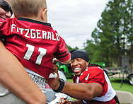Jul. 28, 2012; Flagstaff, AZ, USA; Arizona Cardinals wide receiver Larry Fitzgerald (11) reacts prior to practice at training camp on the campus of Northern Arizona University.  Mandatory Credit: Jennifer Stewart-US PRESSWIRE.