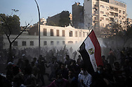 EGYPT, Cairo :  Thousands of  protesters clash with police near the interior ministry in Cairo on February 4, 2012. Egyptian protesters clashed with police for a third straight day as anger against the ruling military mounted..