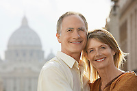 Middle-aged couple hugging in Rome Italy front view portrait