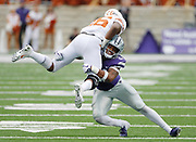 Texas running back Keaontay Ingram (26) is stopped by Kansas State linebacker Adam Davis (26) after a 14-yard gain in the fourth quarter of a college football game in Manhattan, Kan., Saturday, Sept. 29, 2018. (AP Photo/Colin E. Braley)