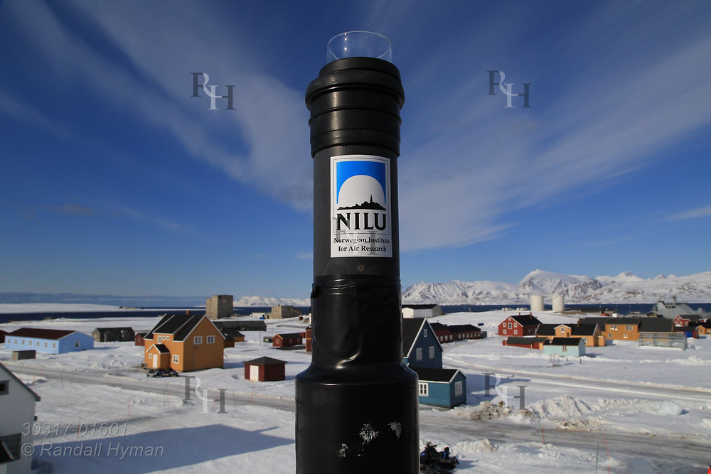 Atmospheric monitoring device on balcony of the Norwegian Polar Institute building overlooks the international science village of Ny-Alesund on Spitsbergen island in Kongsfjorden; Svalbard, Norway.