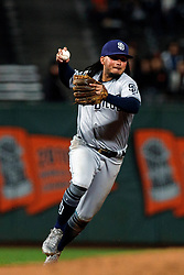 SAN FRANCISCO, CA - SEPTEMBER 24: Freddy Galvis #13 of the San Diego Padres throws to first base against the San Francisco Giants during the eighth inning at AT&T Park on September 24, 2018 in San Francisco, California. The San Diego Padres defeated the San Francisco Giants 5-0. (Photo by Jason O. Watson/Getty Images) *** Local Caption *** Freddy Galvis