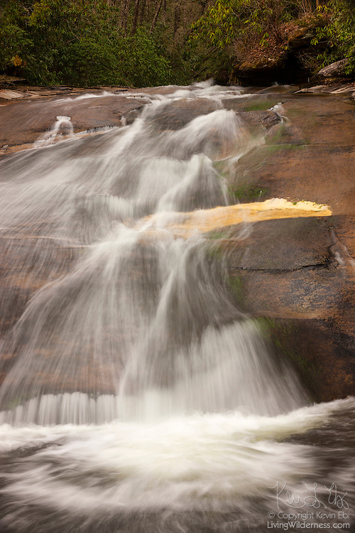 Sliding Rock, a waterfall in the Pisgah National Forest in North Carolina, gently slides about 60 feet (18 meters) over smooth rock. During the summer months, Sliding Rock is a popular tourist attraction with people who use the waterfall as a water slide.