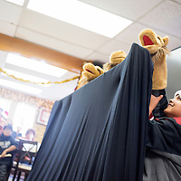 121814       Cable Hoover<br /> <br /> Wyatt Tsosie hides behind a curtain as he and his classmates from Churchrock Academy stage a puppet show Thursday at the Ford Canyon Senior Center in Gallup.