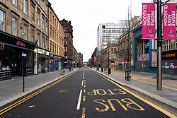 Glasgow, Scotland, UK. 26 March, 2020. Views from city centre in Glasgow on Thursday during the third day of the Government sanctioned Covid-19 lockdown. The city is largely deserted. Only food and convenience stores open. Pictured; Sauchiehall Street is virtually deserted.Iain Masterton/Alamy Live News