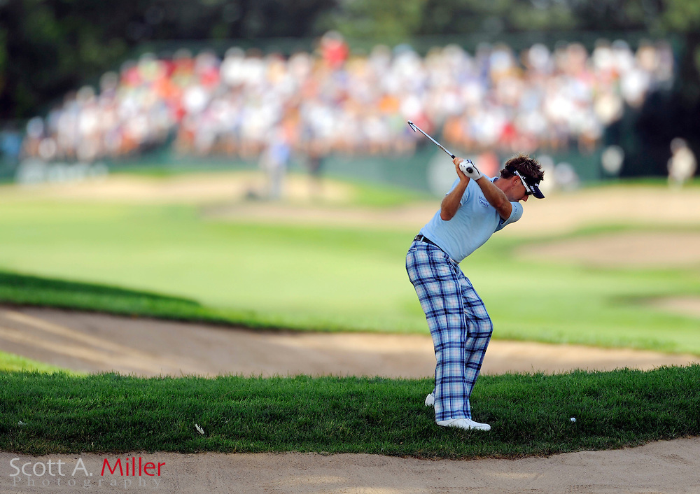 Aug 13, 2009; Chaska, MN, USA; Ian Poulter (GBR) hits out of the rough on the 15th hole during the first round of the 2009 PGA Championship at Hazeltine National Golf Club.  .©2009 Scott A. Miller