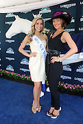 Miss New York Kira Kazantsev, left, poses with Kelly Davis, of New York, on the Longines blue carpet after Davis won the Longines Most Elegant Woman at Belmont fashion contest, Saturday, June 7, 2014, at Belmont Park in New York.  Longines, the Swiss watchmaker known for its elegant timepieces, is the Official Watch and Timekeeper of the 146th running of the Belmont Stakes. (Photo by Diane Bondareff/Invision for Longines/AP Images)