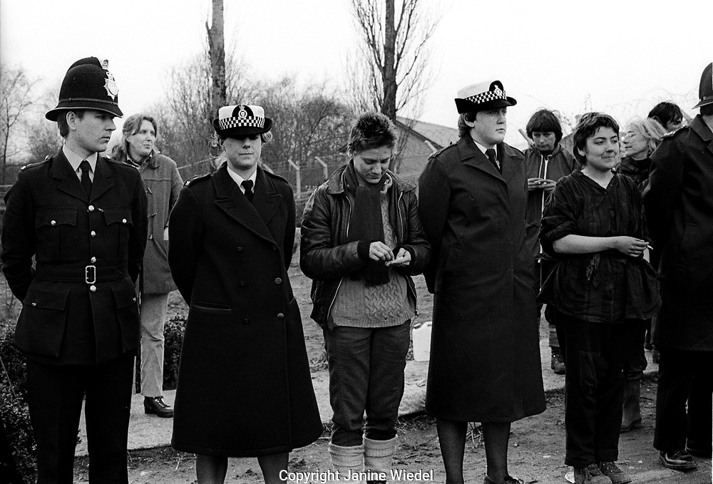 Police and protesters at The anti-nuclear Greenham Common Women's Peace Camp in 1983 / 1984. The women only camp surrounded the RAF  base in Berkshire (UK) where American cruise missiles were being stored.